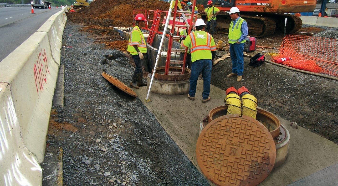 Manhole with fixed covers being installed