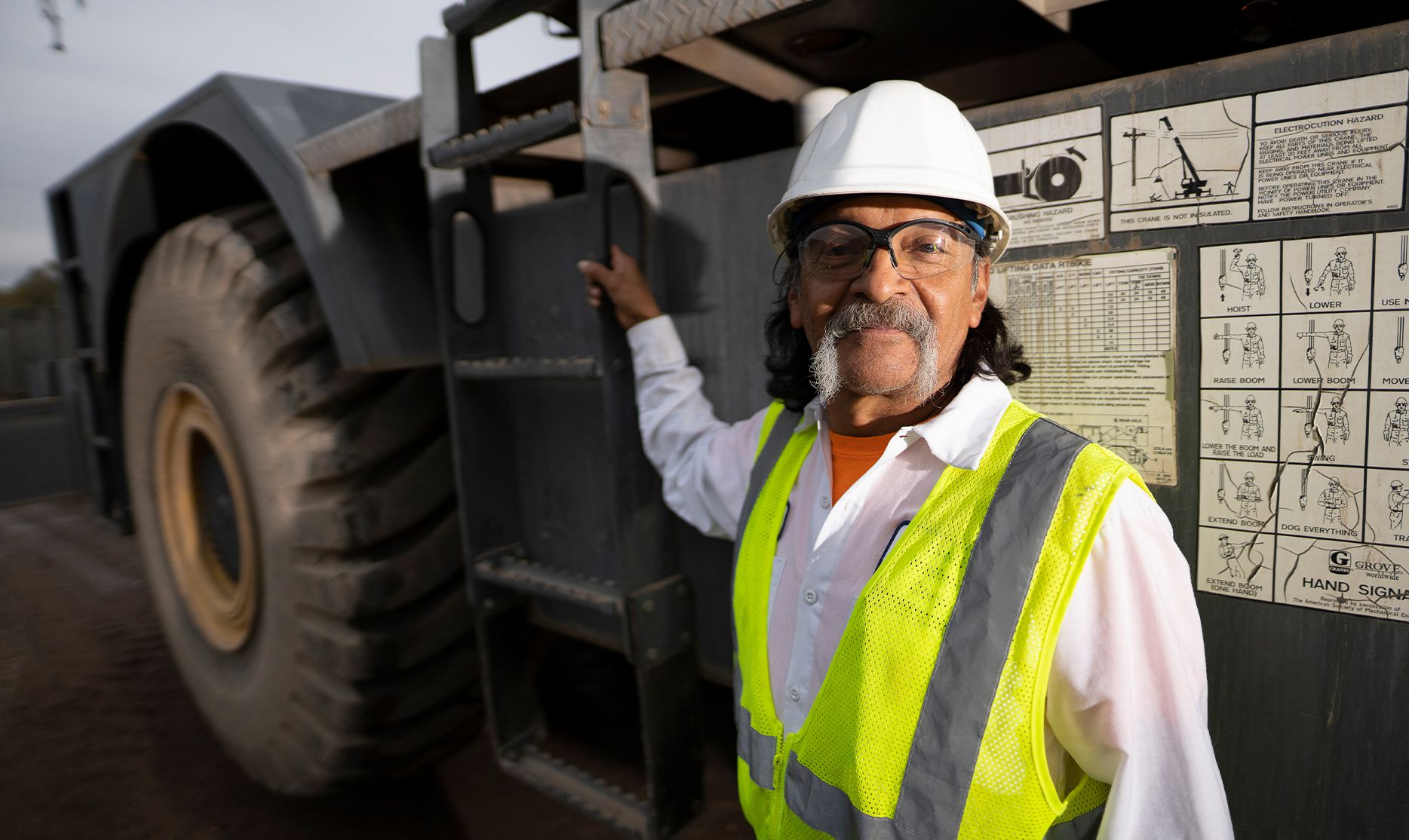 Smith midland worker next to his vehicle