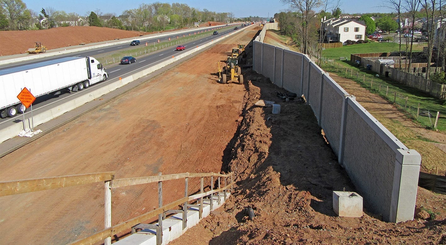 Noise Wall being installed next to a highway