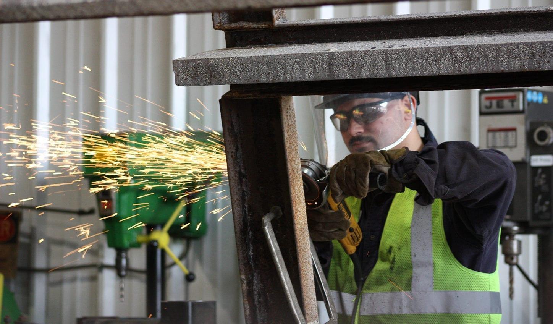 Smith Midland associate welding in the shop