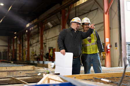 Two Smith Midland associates reviewing a project in the warehouse